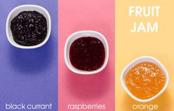 Three bowls with raspberry, orange, blueberry black currant fruit jam. Isolated  background. Top view Stock Image