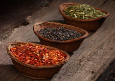 Three bowls with spices over wooden background. Royalty Free Stock Photo
