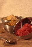 Three bowls of spices and a spoon Stock Photos