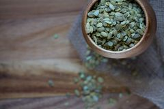 Three Bowls Stacked Top View of Pumpkin Seeds on Wood Royalty Free Stock Image