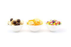 Three bowls of sweets and chocolate jelly mushrooms isolated on white Royalty Free Stock Images