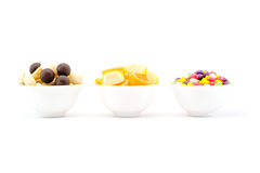 Three bowls of sweets and chocolate jelly mushrooms isolated Stock Image