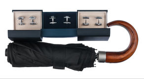 Three boxes with  cufflinks  and umbrella Royalty Free Stock Images