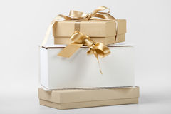 Three boxes with golden ribbon Royalty Free Stock Images