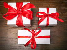 Three boxes with red ribbon Royalty Free Stock Photography