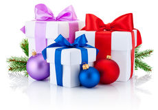 Three boxs tied ribbon bow, pine tree branch and christmas balls Stock Photos