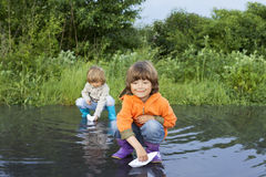 Three boy play in puddle Stock Photography