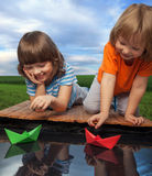 Three boy play in puddle Stock Photos