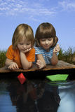 Three boy play in puddle Stock Image