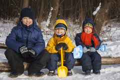 Three boy play on snow Stock Photos