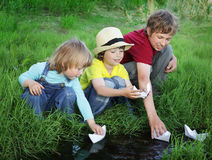 Three boy play in  stream Stock Photography