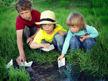 Three boy play in stream Stock Images