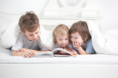 Three boy read book stock photo