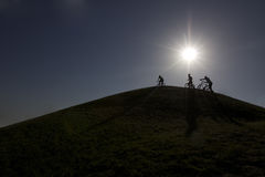 Three boys with bikes on the hill Stock Photos
