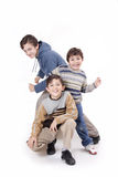Three boys and fashion. Three beautiful and cheerful boys playing on the white background Stock Photography