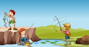Three boys fishing at the river Royalty Free Stock Photos