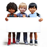 Three boys holding up a empty sign white board with room for your text or copy space Stock Photo