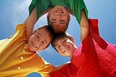 Three Boys Huddling Stock Photo