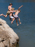 Three Boys Jumping into Lake. This candid shot of three boys was taken using a high shutter speed Stock Image