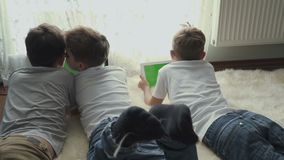 Little boys uses electronic gadgets at home stock footage
