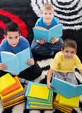 Three boys are learning for school Stock Photos