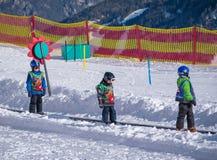 Three boys on a magic carpet. Ski school in Alps, Austria, Zams on 22 Feb 2015. Three boys on a magic carpet. Children learn to ski. Ski school. Ski resort in royalty free stock image
