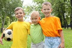 Three boys in the park Stock Images