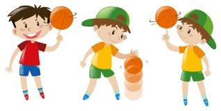 Three boys playing basketball Stock Images