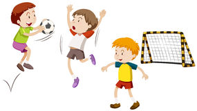 Three boys playing football Royalty Free Stock Image
