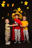 Three boys playing stargazers with a telescope Royalty Free Stock Images