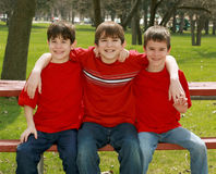Three Boys in Red Stock Photo