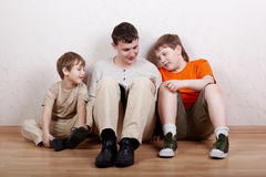 Three boys sit and read book Royalty Free Stock Image