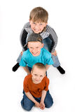 Three boys on a white background Stock Photos