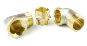 Three brass fitting on a white background Stock Photography
