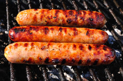 Three Bratwursts on the grill Stock Images