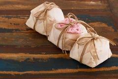 Three Brazilian wedding sweets bem casado with pink crochet hear Royalty Free Stock Photos