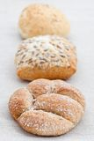 Three bread buns in a row Royalty Free Stock Images