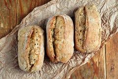 Three bread rolls. Close up of healthy wholegrain crispy bread Stock Image