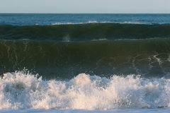 Three Breaking Waves Stock Photography
