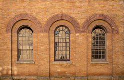 Three brick windows Stock Images