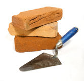 Three bricks with trowel Royalty Free Stock Image