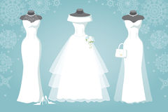 Three bridal dress.Winter Snowflake background. Winter Bridal shower .Three wedding dresses with long scirt wear for mannequin.Falling Snowflake background stock images