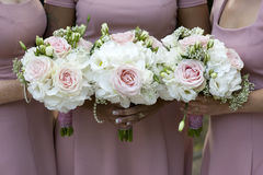Three bridesmaids holding wedding bouquet Royalty Free Stock Photos