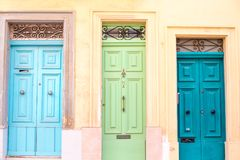 Three bright  ancient doors in a house of Malta. Green and blue Stock Images
