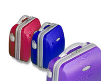 Three bright colored suitcase. Isolated on a white background with clipping path Stock Photos