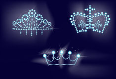 Three bright crowns on dark background Royalty Free Stock Images