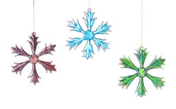 Three Bright Glass Stars Or Snowflakes. Bright glass snowflakes or stars used as holiday ornaments or decorations in a window Royalty Free Stock Images