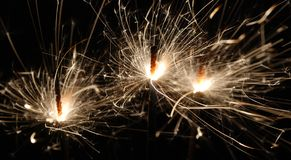 Three Bright Sparklers Stock Images