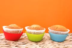 Three bright vanilla muffins Royalty Free Stock Images