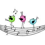 Three brightly colored birds on the stave with treble clef and n Royalty Free Stock Photo